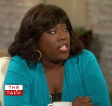 Sheryl Underwood with one of her signature wigs on The Talk.